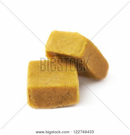 Two bouillon stock broth cubes, composition isolated over the white background ** Note: Shallow depth of field