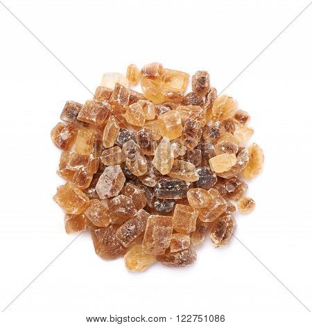 Pile of brown rock sugar crystals isolated over the white background, top view above
