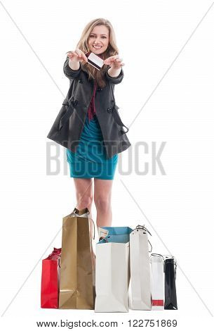 Satisfied and happy woman buyer paid with credit or debit card. Enthusiastic shopping female concept