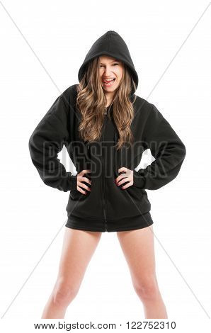 Kinky and sexy young woman wearing a black hoodie on white background