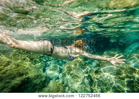 Female snorkeling in the famous Foneas Beach, Kardamili in Mani peninsula, Peloponnese, Greece.