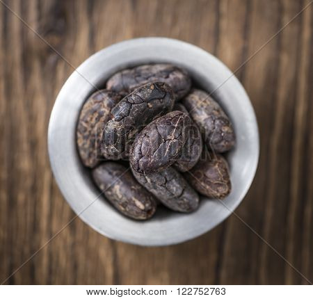 Roasted Cacao Beans in a bowl (selective focus)