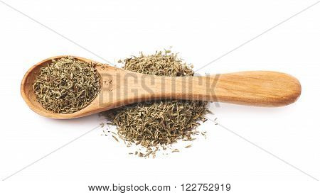 Wooden spoon over the pile of dried thyme seasoning isolated over the white background