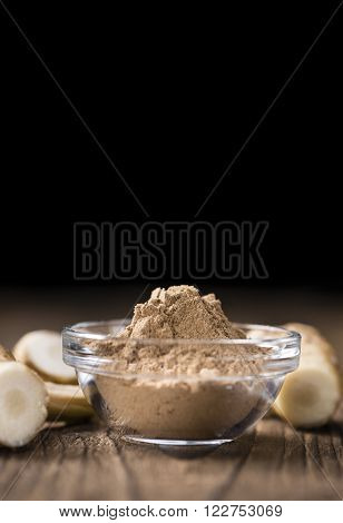 Galangal Powder on an old wooden table
