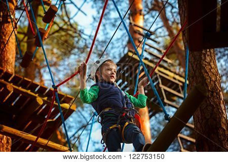 Adventure Climbing High Wire Park - Kid On Course In  Helmet And Safety Equipment