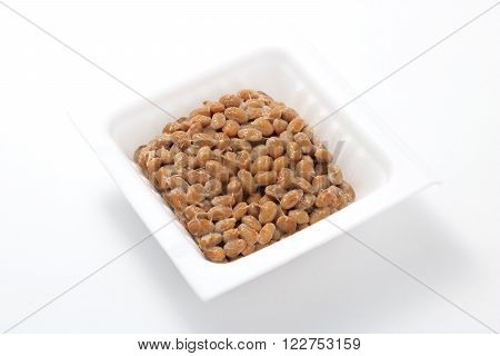 Natto, fermented soybeans on white background. (Japanese food)