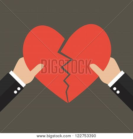 Hands tearing apart heart symbol. Love concept