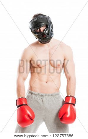 Boxer feeling dissaponted after losing the match and wearing protection helmen and red boxing gloves