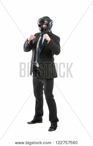 Full body of business man on guard wearing boxing helmet