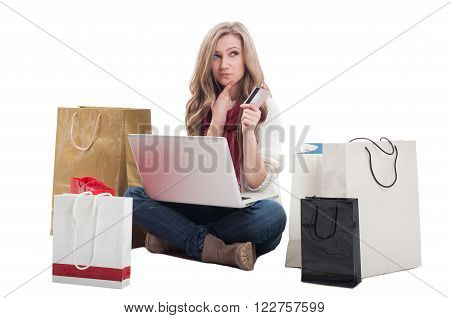 Spending money online using credit or debit card concept with a woman holding a laptop ready to spend money on e-shops