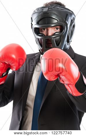 Protected business man concept with suited male wearing protection helmet and boxing gloves