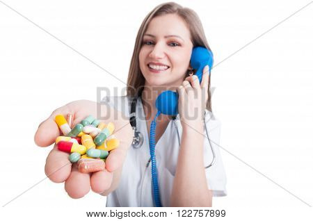Woman Doctor Talking On The Phone And Offering Pills