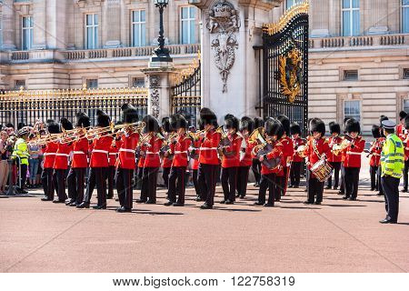 London UK - June 12 2006: British Royal guards performing the changing of the Guard at Buckingham Palace. The ceremony is one of the top attractions in London