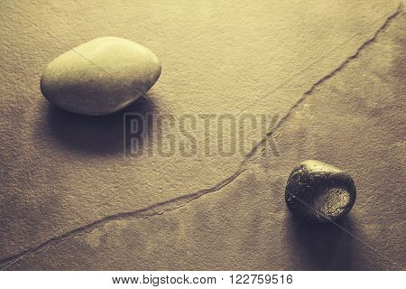 Retro Stylized Stones On A Cracked Slate, Abstract Natural Background.