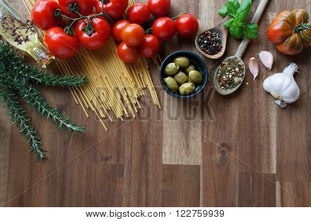 Still life with vegetables herbs and spices for italian pasta