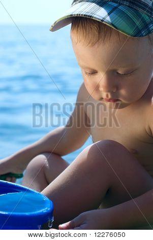 A Little Boy At The Beach