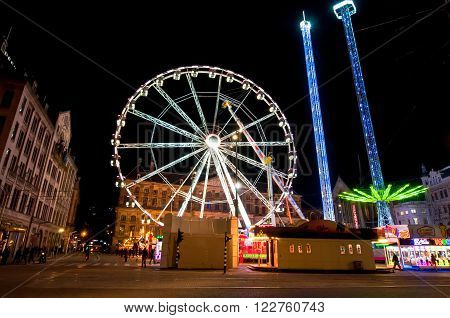 AMSTERDAMNETHERLANDS-APRIL 27: Big wheel on Dam Square at night on King's Day on April 27, 2015 in Amsterdam. King's Day is the largest open-air festivity in Amsterdam.
