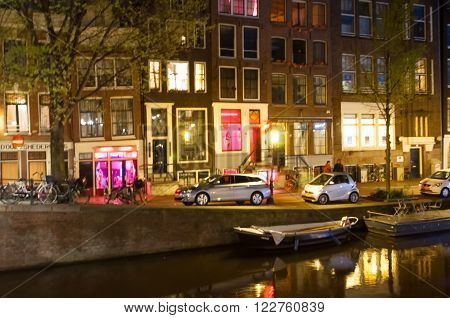 AMSTERDAM-APRIL 29: Red light district at night on April 29 2015. The red-light district is a part of city where prostitution is concentrated.