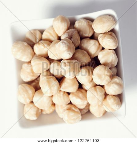 Nuts. Macadamia in a dish