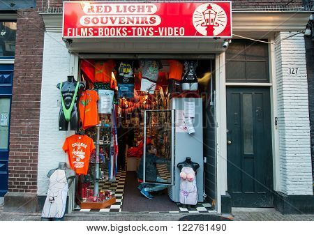 AMSTERDAM-APRIL 27: Souvenir shop in red light district during King's Day on April 27 2015 in Amsterdam the Netherlands.