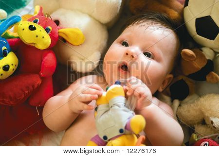 A Baby Surrounded By Toys