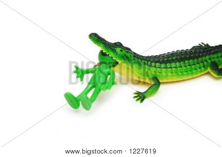 Fugures Of Crocodile Eating A Smilie Isolated On White