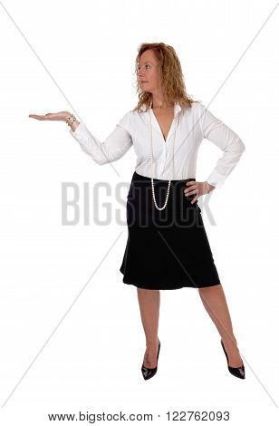 A middle age business woman in a black skirt and white blouse standing with a outstretched hand isolated for white background.