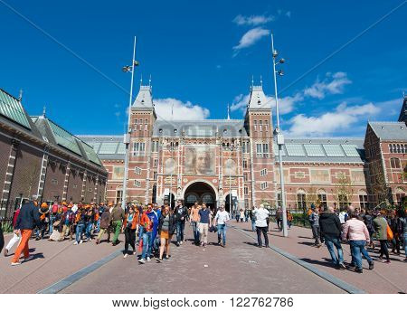 AMSTERDAM-APRIL 27: The Rijksmuseum on King's Day people walk to a public space (Museumplein) on April 27 2015. The Rijksmuseum is a Netherlands national museum dedicated to arts and history.