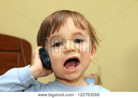 child in a call center with old phones
