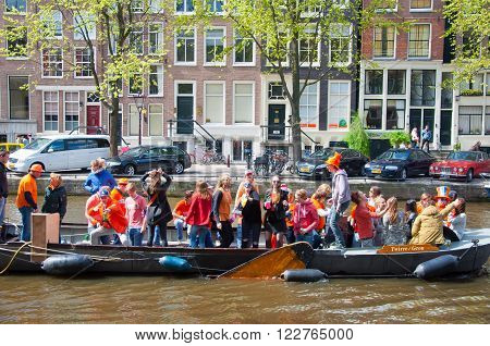 AMSTERDAM-APRIL 27: King's Day boating people have fun on the boats on April 27 2015 in Amsterdam the Netherlands. King's Day (Koningsdag) is held on 27 April (the king's birthday) every year.