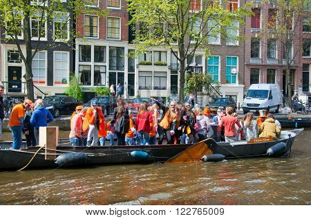 AMSTERDAM-APRIL 27: King's Day boating locals have fun on the boats on April 27 2015 in Amsterdam the Netherlands. King's Day (Koningsdag) is held on 27 April every year.