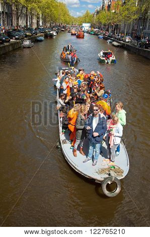 AMSTERDAM - APRIL 27: People on Party Boat with unlimited beer soda and wine aboard on King's Day on April 27, 2015. King's Day is the largest open-air festivity in Amsterdam the Netherlands.