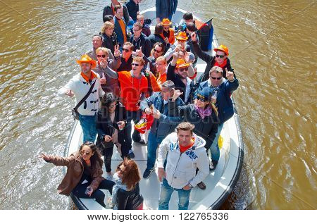 AMSTERDAM, NETHERLANDS - APRIL 27: Boat party during King's Day on April 27, 2015 in Amsterdam. Kings Day is biggest festival celebrating the birth of Dutch royalty.