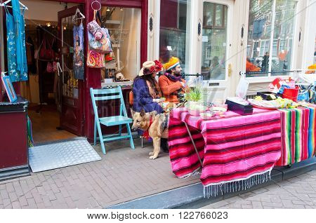 AMSTERDAMNETHERLANDS-APRIL 27: Local people display their things for sale on King's Day on April 27 2015 in Amsterdam Netherlands. King's Day is the largest open-air festivity in Amsterdam.