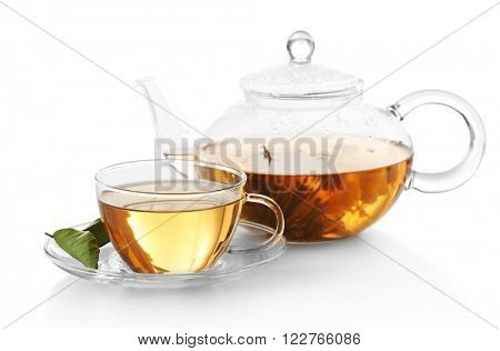 Cup of tea and teapot isolated on white