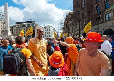 AMSTERDAM, NETHERLANDS-APRIL 27: People in traditional orange on Dam Square during King's Day on April 2727 in Amsterdam the Netherlands. King's Day is the largest open-air festivity in Amsterdam.