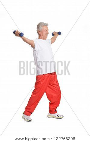 Senior woman exercising with dumbbells on white background