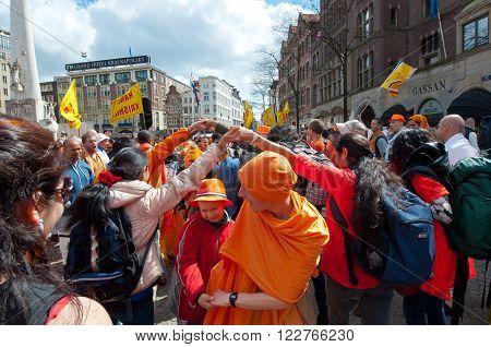 AMSTERDAM, NETHERLANDS-APRIL 27: Locals and tourists in orange celebrate King's Day on April 272015 in Amsterdam. King's Day is the largest open-air festivity in Amsterdam the Netherlands.