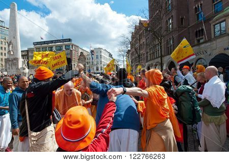 AMSTERDAM, NETHERLANDS-APRIL 27: Locals and tourists in orange clothes celebrate King's Day on April 272015 in Amsterdam. King's Day is the largest open-air festivity in Amsterdam the Netherlands.