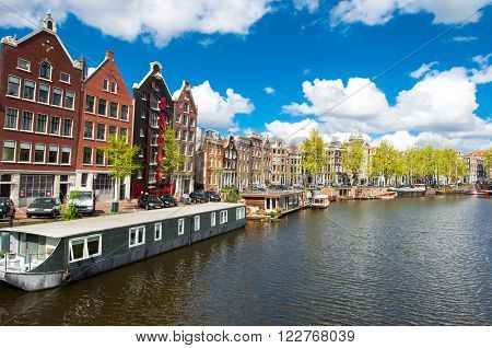 Amsterdam the Netherlands-April 27: Traditional Amsterdam cityscape with medival houses on April 272015. Amsterdam is the most populous city of the Kingdom of the Netherlands.