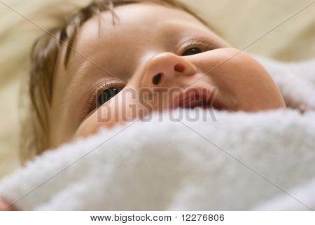 A Little Boy Lying On Sofa