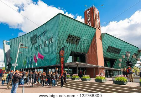 AMSTERDAM-APRIL 27: Science Center and Museum Nemo group of tourists are going to visit the museum on April 272015. Science Center Nemo is a science center in Amsterdam Netherlands.