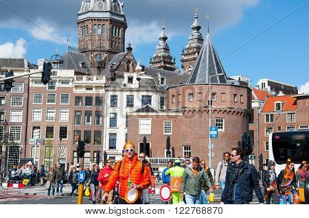 AMSTERDAM - APRIL 27: Amsterdam cityscape during King's Day people in orange go to take part in festival on April 27, 2015 the Netherlands. The King Day is celebrated every year in April 27.