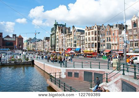 AMSTERDAM, NETHERLANDS - April 27, 2015: Rokin busy street during the King's Day on April 27, 2015 in Amsterdam. Koningsdag or King's Day is a national holiday in the Kingdom of the Netherlands celebrated on 27 April.