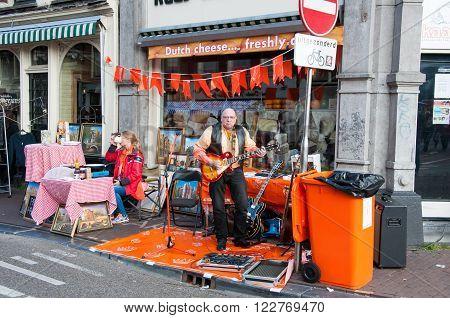 AMSTERDAMNETHERLANDS-APRIL 27: Street musician on the street on King's Day on April 272015. Koningsdag or King's Day is a national holiday in the Kingdom of the Netherlands celebrated on 27 April.