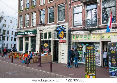 AMSTERDAMNETHERLANDS: Row of Amsterdam coffeeshops in down town on April 272015 the Netherlands.