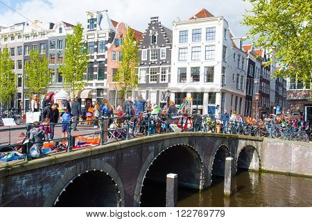AMSTERDAMNETHERLANDS-APRIL 27: Local people put up their things for sale on King's Day on April 27 2015 in Amsterdam Netherlands.