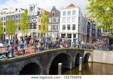 AMSTERDAMNETHERLANDS-APRIL 27: Locals put up their things for sale on King's Day on April 27 2015 in Amsterdam Netherlands.