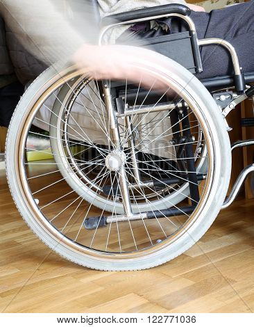 Hand Of The Disabled Man In The Wheel Of The Wheelchair