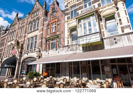 AMSTERDAMNETHERLANDS-APRIL 27: Local outside cafe on the Rokin street during King's Day on April 272015 in Amsterdam the Netherlands.